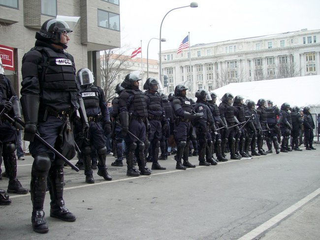 riot police catholic media