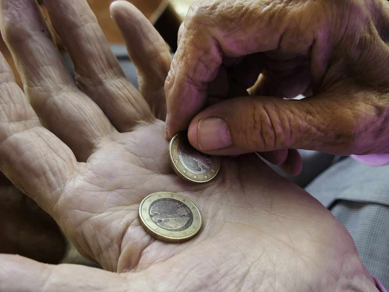 hands coins alms